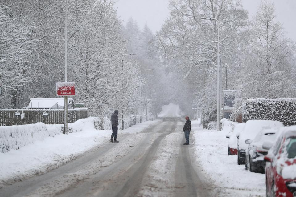 People in snowy conditions in Braco, near Dunblane in Scotland. (Photo by Andrew Milligan/PA Images via Getty Images)