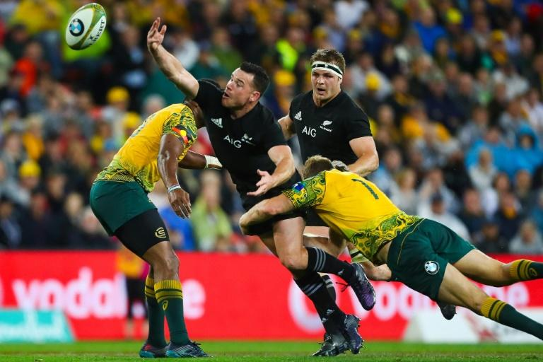 Ryan Crotty of New Zealand's All Blacks (2nd L) loses the ball as Michael Hooper of Australia's Wallabies tackles during their match in Brisbane on October 21, 2017