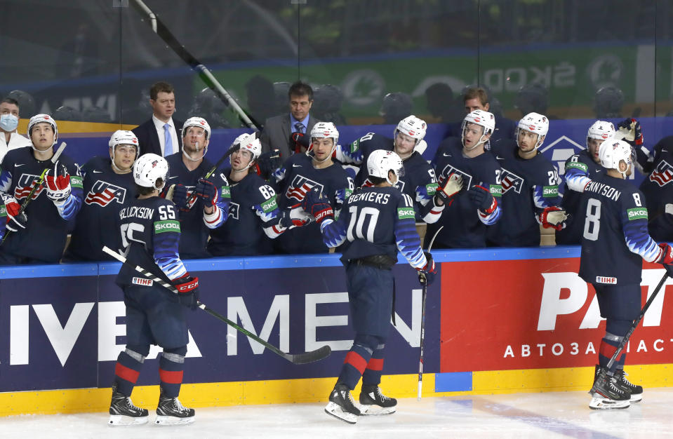 US players celebrate after Jack Drury of the US scored his side's third goal during the Ice Hockey World Championship group B match between United States and Kazakhstan at the Arena in Riga, Latvia, Tuesday, May 25, 2021. (AP Photo/Sergei Grits)