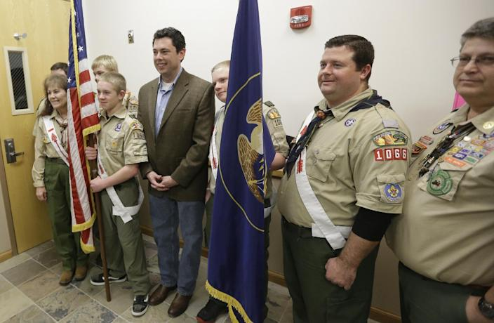 In this Feb. 7, 2013 photo, Rep. Jason Chaffetz, R-Utah, poses with a group of Boy Scouts at a town hall meeting in Heber City, Utah. Chaffetz flew home from Washington last week to attend the town hall meeting. Many voters here and in similar communities elsewhere still want to do whatever it takes to stop President Barack Obama, and the politicians they elect are listening. (AP Photo/Rick Bowmer)