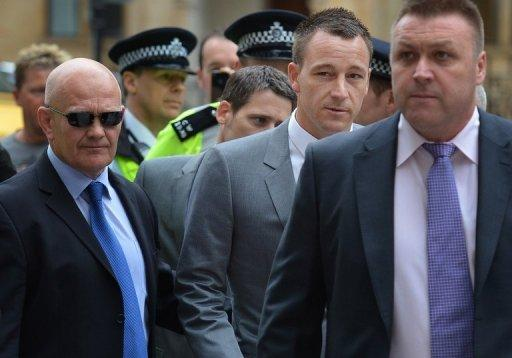 Chelsea and England footballer John Terry (2nd R) arrives at Westminster Magistrates court in London. Terry racially abused rival footballer Anton Ferdinand in response to taunts about his alleged affair with a teammate's girlfriend, a court heard Monday