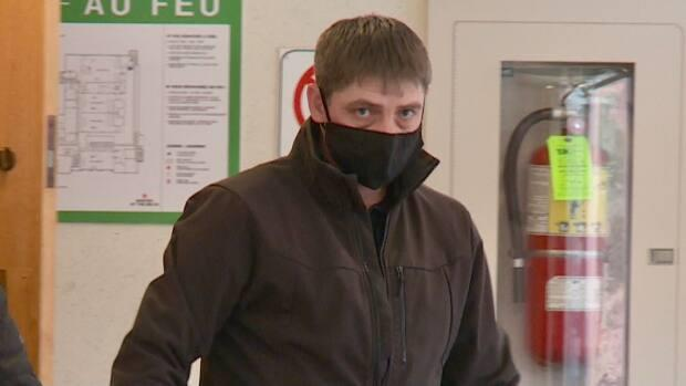 Stephen Paul Collings leaves P.E.I. Supreme Court Jan. 21.  He was sentenced Wednesday to 15 months in jail, having previously pleaded guilty to three counts of impaired driving causing bodily harm.  (Steve Bruce/CBC - image credit)