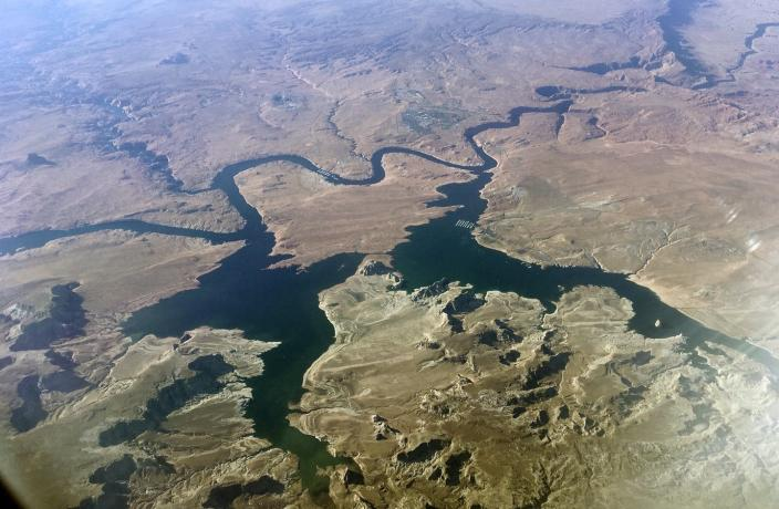 """<span class=""""caption"""">Aerial view of Lake Powell on the Colorado River along the Arizona-Utah border.</span> <span class=""""attribution""""><a class=""""link rapid-noclick-resp"""" href=""""https://newsroom.ap.org/detail/ColoradoRiverManagement/d12a55f700714682baf7468c24e4aea4/photo"""" rel=""""nofollow noopener"""" target=""""_blank"""" data-ylk=""""slk:AP Photo/John Antczak"""">AP Photo/John Antczak</a></span>"""
