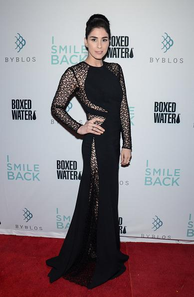 "<p>Comedienne Sarah Silverman takes a dark turn in the film ""I Smile Back,"" and her fashion has shifted to align with this new direction. Usually more goofy on the red carpet — she's been known to wear pigtails and pull dresses from her own closet for major industry events — the actress opted for a floor-sweeping gown. The black dress, worn at the TIFF Dinner hosted by Boxed Water, features cutouts all over from the stomach to the thighs covered in a sheer material</p>"