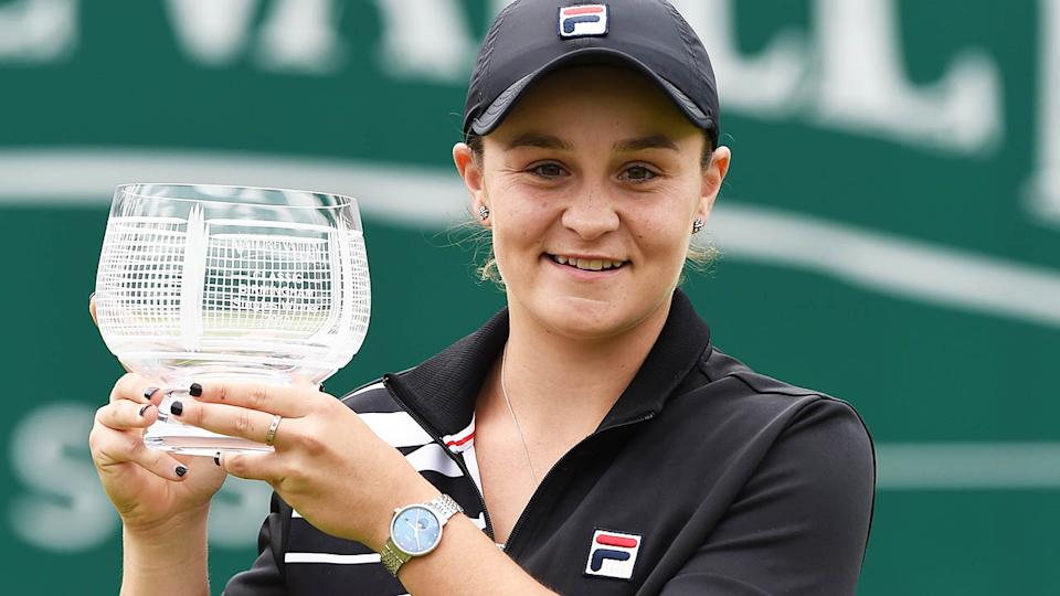 Ashleigh Barty poses with the trophy.. (Photo by PAUL ELLIS/AFP/Getty Images)