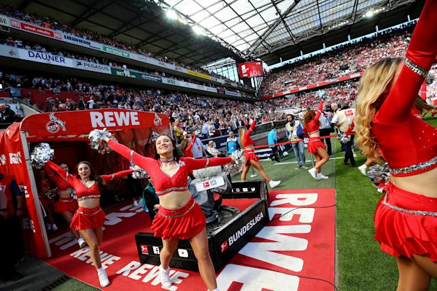 Soccer Football - Bundesliga - FC Cologne vs 1.FSV Mainz 05 - RheinEnergieStadion, Cologne, Germany - April 7, 2018 Cologne cheerleaders before the match REUTERS/Wolfgang Rattay DFL RULES TO LIMIT THE ONLINE USAGE DURING MATCH TIME TO 15 PICTURES PER GAME. IMAGE SEQUENCES TO SIMULATE VIDEO IS NOT ALLOWED AT ANY TIME. FOR FURTHER QUERIES PLEASE CONTACT DFL DIRECTLY AT + 49 69 650050