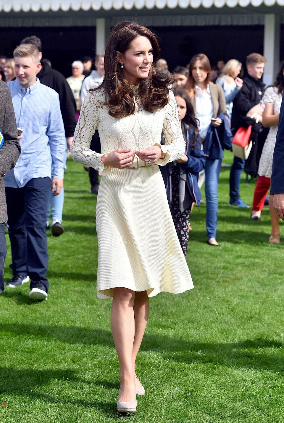 <p>In her lemon See by Chloé dress at a tea party she hosted for the children of servicemen at Buckingham Palace. She wore the same dress to a children's tea party in Canada in September 2016.</p>