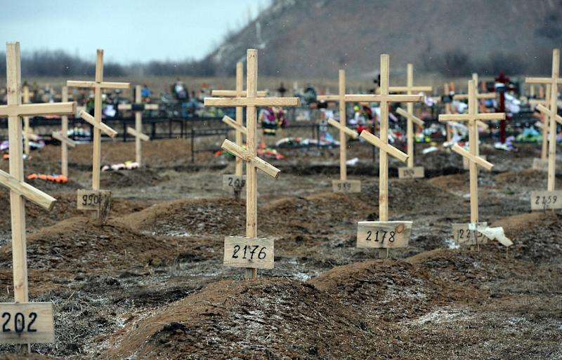 Crosses stand on the graves of unknown pro-Russian separatists at a cemetery in the eastern Ukrainian city of Donetsk, on February 16, 2015