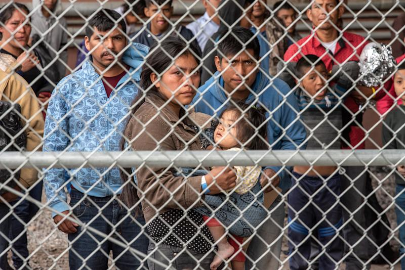 Migrants at a makeshift detention center in El Paso, Texas, on March 27. (Photo: Sergio Flores for the Washington Post via Getty Images)