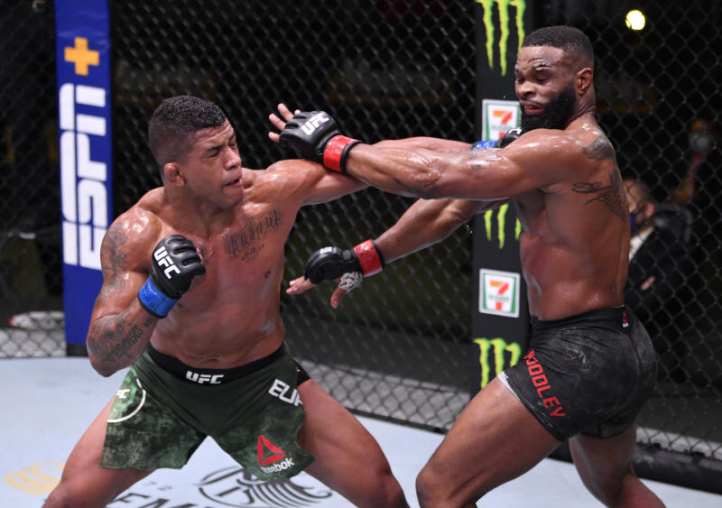 LAS VEGAS, NEVADA - MAY 30: (L-R) Gilbert Burns of Brazil punches Tyron Woodley in their welterweight fight during the UFC Fight Night event at UFC APEX on May 30, 2020 in Las Vegas, Nevada. (Photo by Jeff Bottari/Zuffa LLC)