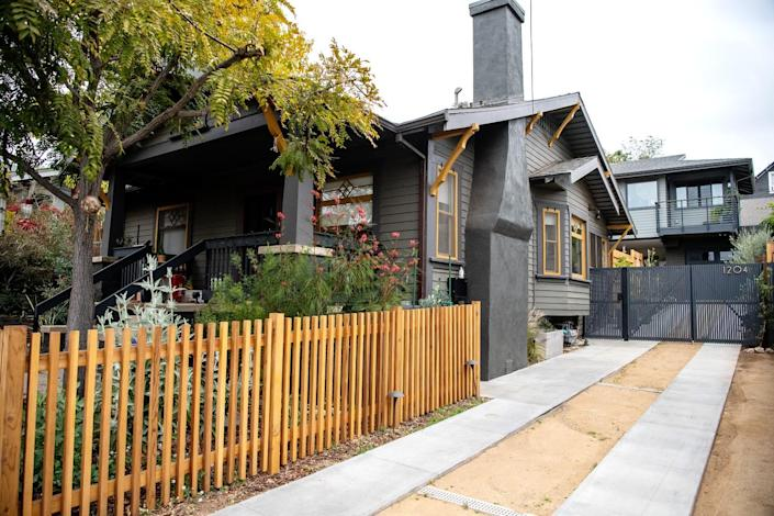 An elevated ADU sits behind a 1914 Craftsman home in Echo Park.