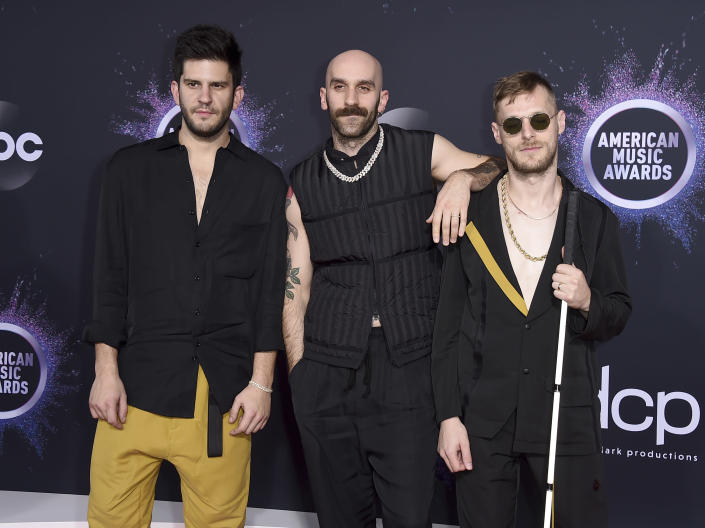 """FILE - Adam Levin, from left, Sam Harris, and Casey Harris, of X Ambassadors, appear at the American Music Awards in Los Angeles on Nov. 24, 2019. The band's latest album """"The Beautiful Liar,"""" released Friday. (Photo by Jordan Strauss/Invision/AP)"""