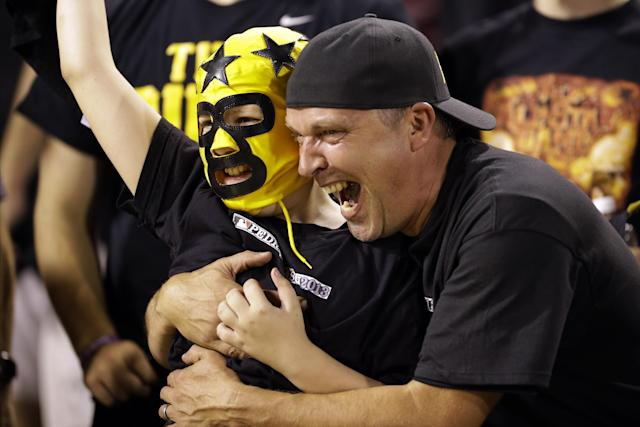 A pair of Pittsburgh Pirates fans celebrate after the team defeated the St. Louis Cardinals in Game 3 of a National League division baseball series on Sunday, Oct. 6, 2013, in Pittsburgh. The Pirates won 5-3 to take a two games to one lead in the best-of-five series. (AP Photo/Gene J. Puskar)