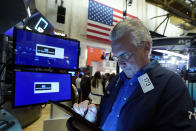 Trader Frank O'Connell works on the floor of the New York Stock Exchange, Wednesday, Sept. 22, 2021. Stocks rose broadly on Wall Street Wednesday ahead of an update from the Federal Reserve on how and when it might begin easing its extraordinary support measures for the economy. (AP Photo/Richard Drew)