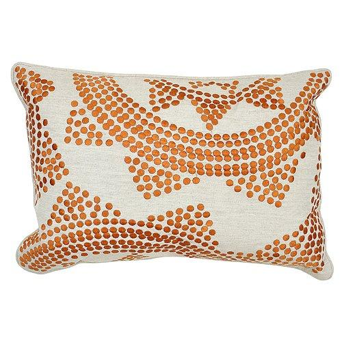 Dress up your couch or bed with a throw pillow set patterned with geometric copper designs ($130).