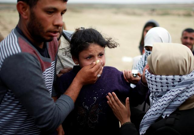 <p>A Palestinian girl reacts to tear gas fired by Israeli troops near the Israel-Gaza border during a tent city protest demanding the right to return to their homeland, east of Gaza City, April 3, 2018. (Mohammed Salem/Reuters) </p>