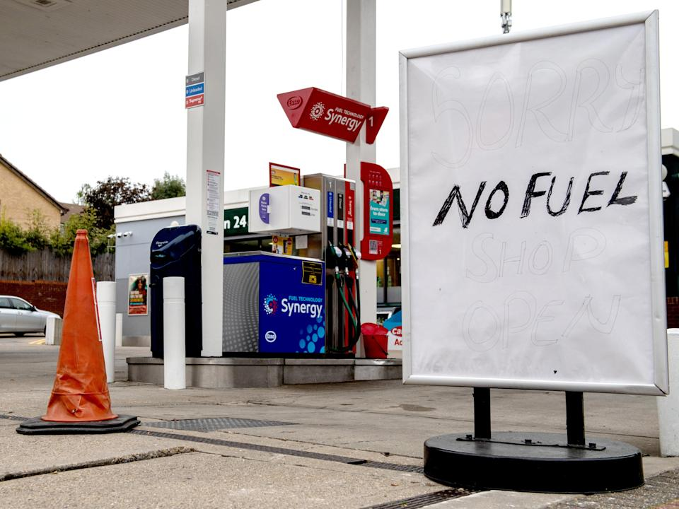 A sign outside an Esso garage informing the public that they have no fuel on Saturday (Getty)