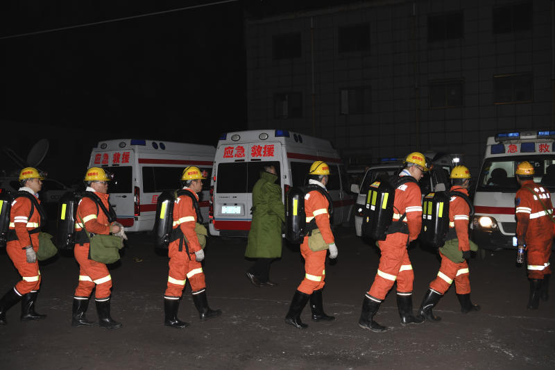 In this Nov. 18, 2019, photo released by China's Xinhua News Agency, rescuers prepare to enter a coal mine that was the site of a gas explosion in Pingyao county in northern China's Shanxi Province. Authorities in northern China say more than a dozen people were killed and others injured in a gas explosion inside a coal mine on Monday afternoon. (Yang Chenguang/Xinhua via AP)