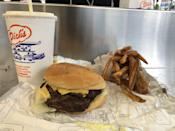 """<p>There are few burgers more iconic in Seattle than the ones you will find at the seven locations of Dick's Drive-In. For about $2, you'll get a small but mighty burger with a slice of classic American cheese. Like any good drive-in, Dick's has some <a href=""""https://www.thedailymeal.com/cook/dessert-recipes-frozen-fruit?referrer=yahoo&category=beauty_food&include_utm=1&utm_medium=referral&utm_source=yahoo&utm_campaign=feed"""" rel=""""nofollow noopener"""" target=""""_blank"""" data-ylk=""""slk:creamy, dreamy milkshakes"""" class=""""link rapid-noclick-resp"""">creamy, dreamy milkshakes</a>, but the menu is simple: three flavors (vanilla, chocolate or strawberry) and just one size only.</p>"""