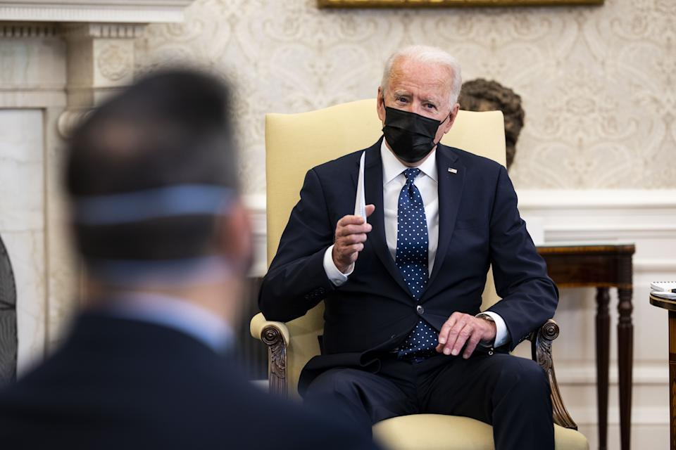 U.S. President Joe Biden wears a protective mask while speaking during a meeting with the Congressional Hispanic Caucus in the Oval Office of the White House in Washington, D.C., U.S., on April 20, 2021. (Doug Mills/The New York Times/Bloomberg via Getty Images)