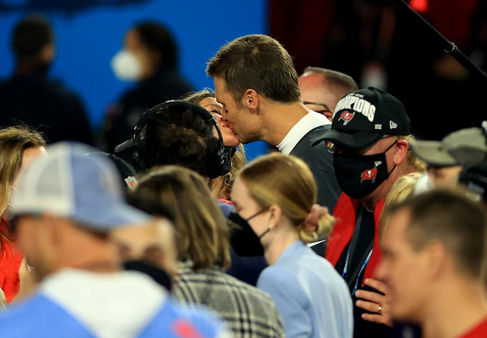 TAMPA, FLORIDA - FEBRUARY 07: Tom Brady #12 of the Tampa Bay Buccaneers celebrates with Gisele Bundchen after winning Super Bowl LV at Raymond James Stadium on February 07, 2021 in Tampa, Florida. (Photo by Mike Ehrmann/Getty Images)