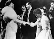 <p>Italian actress Sophia Loren met Queen Elizabeth at a London premiere in 1957 and wore a lace jacket with white fur trimmed sleeves over her strapless gown for the event.</p>