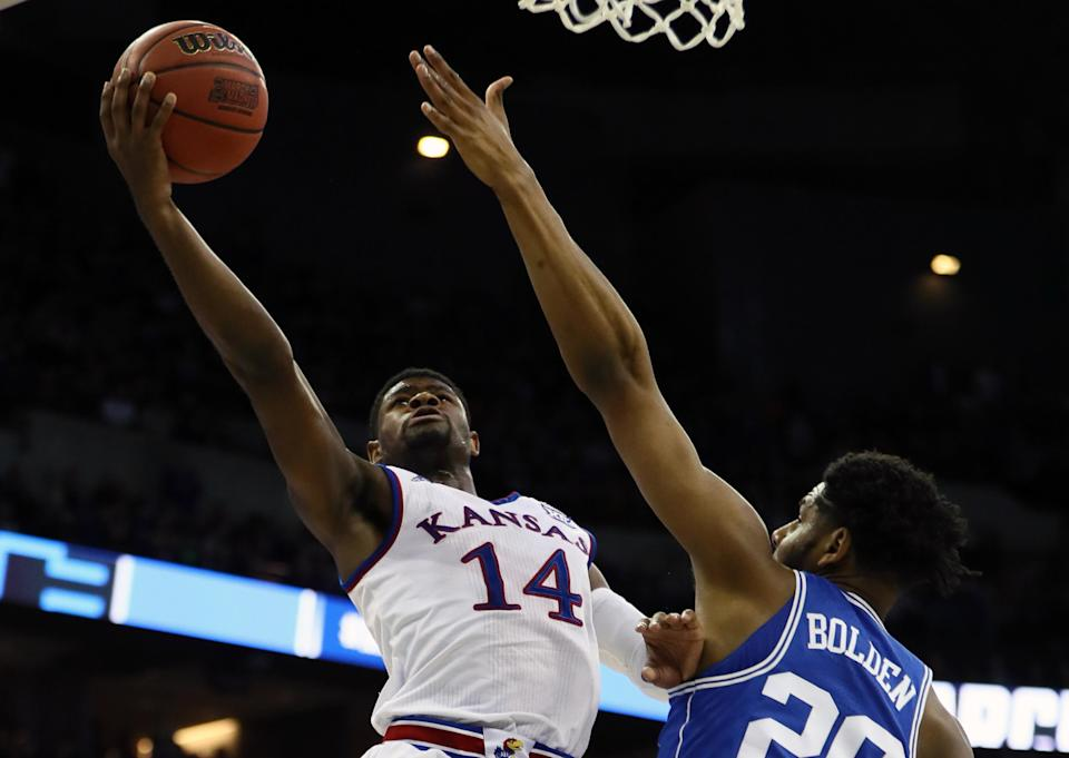 Malik Newman drives to the basket against Duke in the Elite Eight. (Getty)