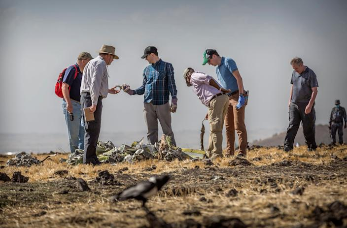 Foreign investigators examine wreckage at the scene where the Ethiopian Airlines Boeing 737 Max 8 crashed shortly after takeoff on Sunday killing all 157 on board, near Bishoftu, or Debre Zeit, south of Addis Ababa, in Ethiopia March 12, 2019. (Photo: Mulugeta Ayene/AP)