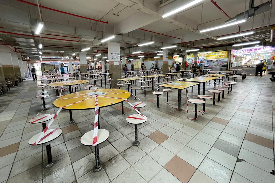 Cordoned off tables seen at the People's Park Food Centre on 24 May 2021 amid Singapore's Phase 2 (Heightened Alert) period. (PHOTO: Dhany Osman / Yahoo News Singapore)