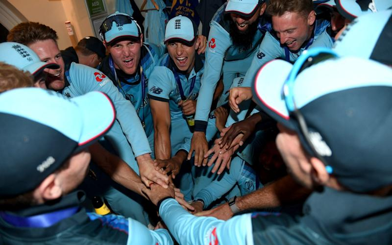England celebrate in the dressing rooms after winning the Final of the ICC Cricket World Cup 2019 between England and New Zealand at Lord's Cricket Ground on July 14, 2019 in London, England - GETTY IMAGES