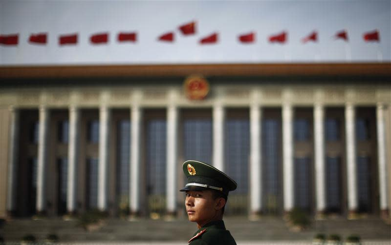 File picture shows a paramilitary police officer standing in front of the Great Hall of the People at Beijing's Tiananmen Square