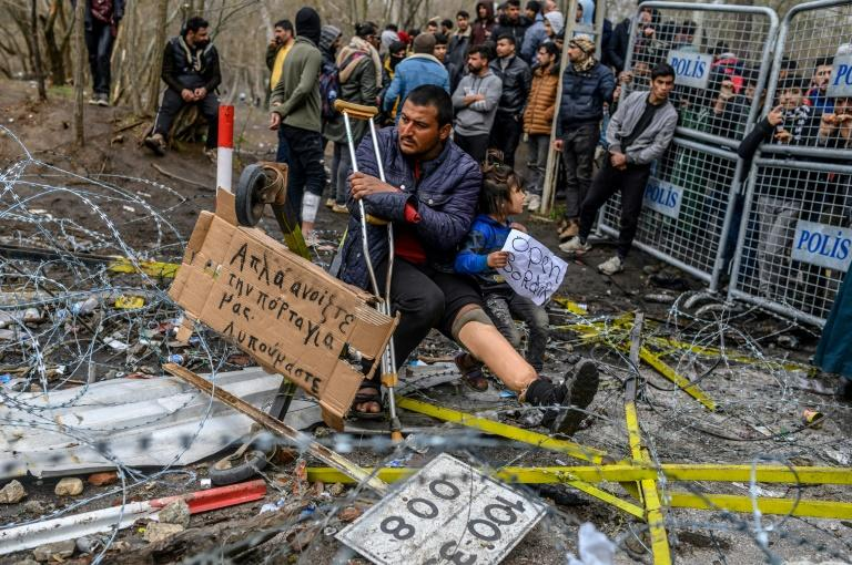 Greek officials accused Turkey of firing tear gas and smoke bombs at their border guards and providing cutters to migrants to break through fencing