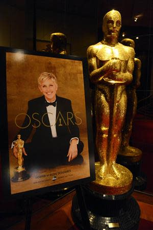 An Oscar statue and poster with host Ellen Degeneres is seen at the 86th Academy Awards nominee announcements in Beverly Hills, California January 16, 2014. REUTERS/Phil McCarten