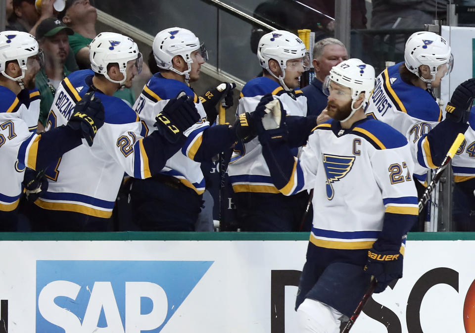 St. Louis Blues' Alex Pietrangelo (27) is congratulated by teammates after scoring during the first period in Game 6 of an NHL second-round hockey playoff series against the Dallas Stars, Sunday, May 5, 2019, in Dallas. (AP Photo/Tony Gutierrez)