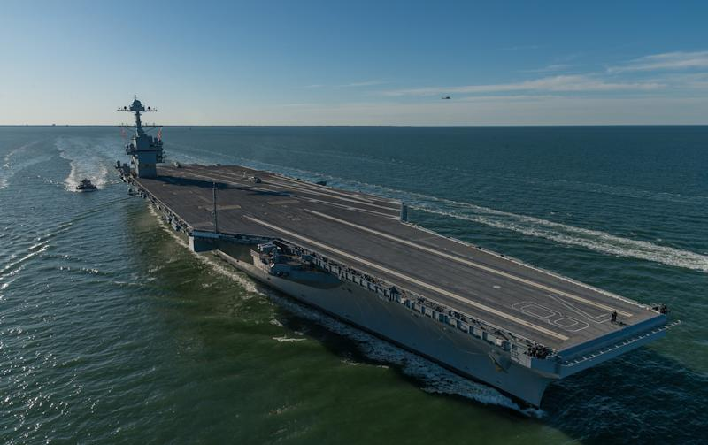 Aircraft carrier USS Gerald R. Ford steams in open waters.