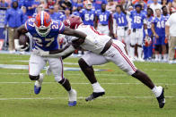 Florida running back Dameon Pierce (27) tries to break a tackle by Alabama linebacker Christian Harris (8) during the first half of an NCAA college football game, Saturday, Sept. 18, 2021, in Gainesville, Fla. (AP Photo/John Raoux)