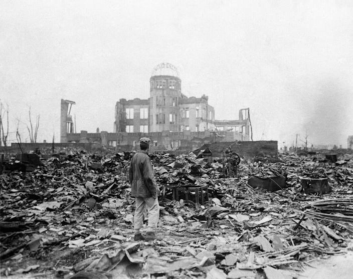 An Allied correspondent stands in the rubble in front of the shell of a building that once was a movie theater in Hiroshima, Japan, on Sept. 8, 1945, a month after the first atomic bomb ever used in warfare was dropped by the U.S.