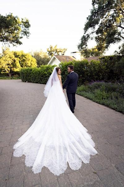 Get the scoop on the bride's wedding gown and reception dress, custom designed by Giorgio Armani.