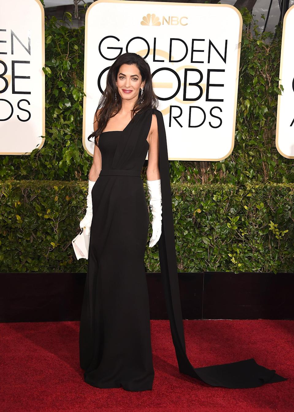 <p>Amal wore Dior Haute Couture, Harry Winston jewels, and her own gloves to the 2015 Golden Globe Awards.</p>