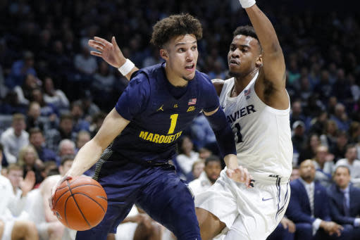 FILE - In this Wednesday, Jan. 29, 2020, file photo, Marquette's Brendan Bailey, left, drives against Xavier's Paul Scruggs (1) during the first half of an NCAA college basketball game in Cincinnati. Bailey is bypassing his final two seasons of eligibility to pursue a pro career. (AP Photo/John Minchillo, File)