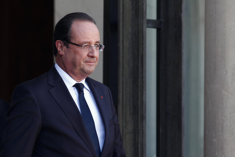 France's President Francois Hollande waits prior to welcome German President Joachim Gauck, prior to a meeting, at the Elysee Palace, in Paris, Tuesday, Sept. 3, 2013. The German head of state is in France for a three-day state visit. (AP Photo/Thibault Camus)