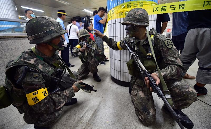 South Korean soldiers take a position during an anti-terror drill on the sidelines of South Korea-US joint military exercise, Ulchi Freedom Guardian, at a metro station in Seoul, in 2015 (AFP Photo/JUNG YEON-JE)