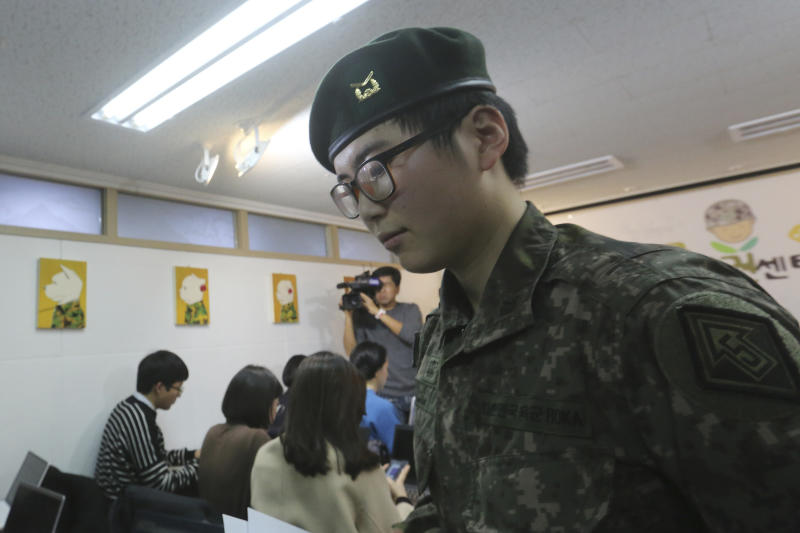 South Korean army Sergeant Byun Hui-su leaves after a press conference at the Center for Military Human Right Korea in Seoul, South Korea, Wednesday, Jan. 22, 2020. South Korea's military decided Wednesday to discharge Byun who recently undertook gender reassignment surgery, a ruling expected to draw strong criticism from human rights groups. (AP Photo/Ahn Young-joon)