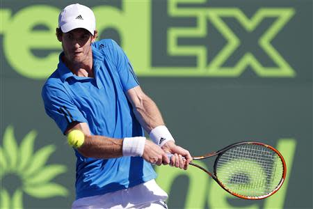 Mar 25, 2014; Miami, FL, USA; Andy Murray hits a backhand against Jo-Wilfried Tsonga (not pictured) on day nine of the Sony Open at Crandon Tennis Center. Geoff Burke-USA TODAY Sports