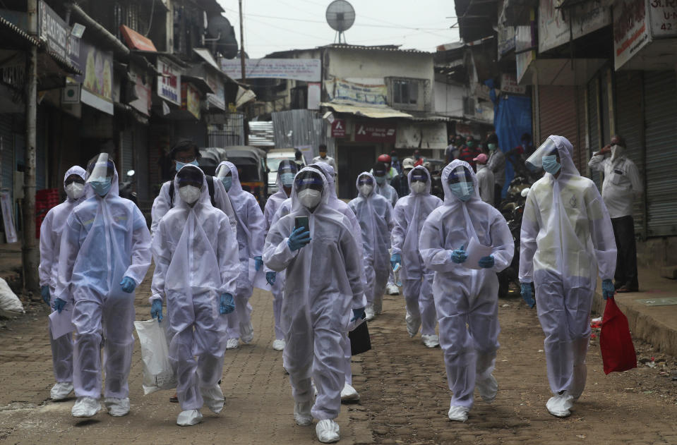 Health workers arrive to administer a medical camp in a slum in Mumbai, India, Sunday, June 28, 2020. India is the fourth hardest-hit country by the COVID-19 pandemic in the world after the U.S., Russia and Brazil. (AP Photo/Rafiq Maqbool)