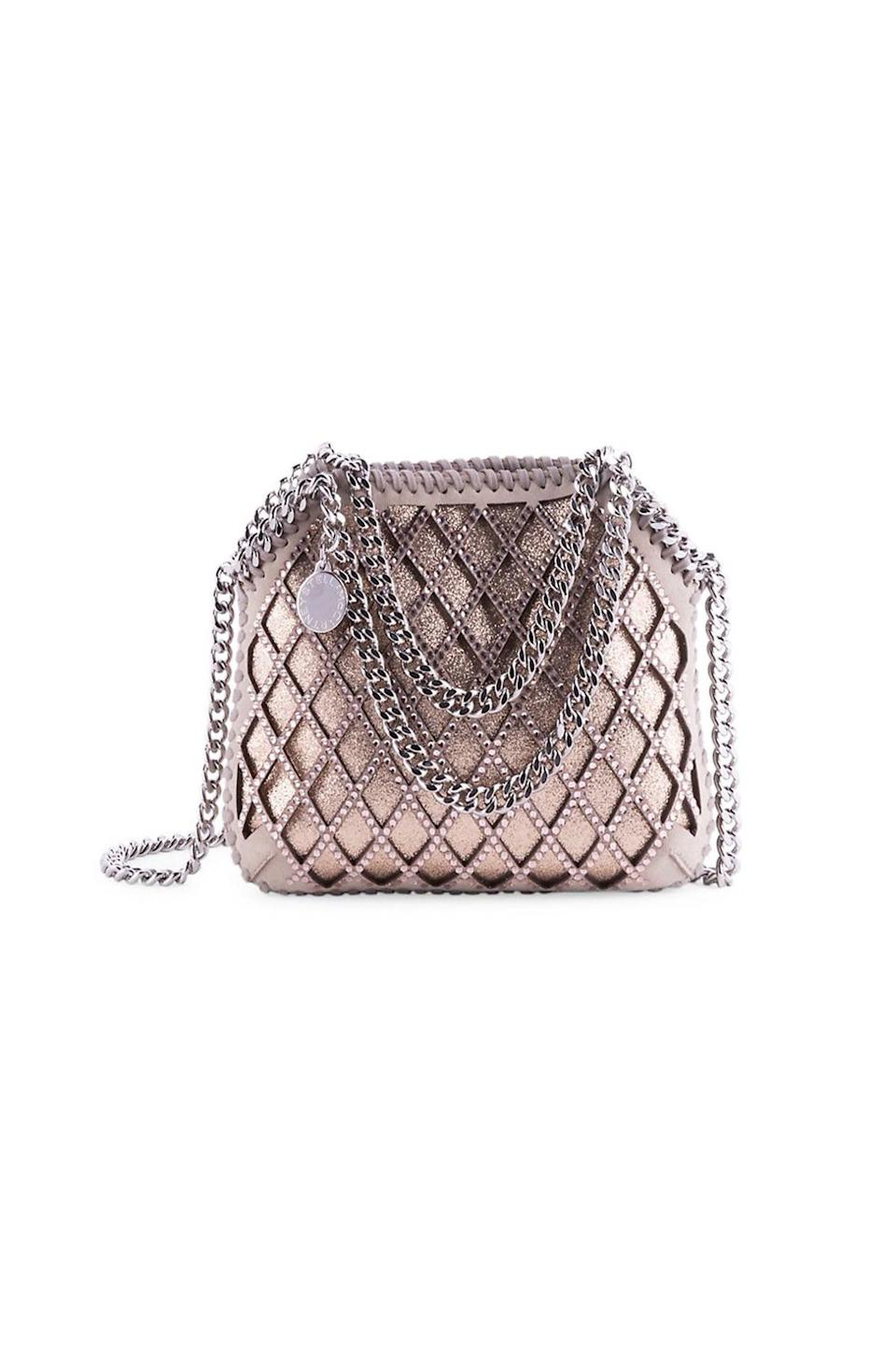 """<p><strong>Stella McCartney</strong></p><p>saksfifthavenue.com</p><p><strong>$775.00</strong></p><p><a href=""""https://go.redirectingat.com?id=74968X1596630&url=https%3A%2F%2Fwww.saksfifthavenue.com%2Fproduct%2Fstella-mccartney-tiny-falabella-embellished-lattice-metallic-tote-0400013309519.html&sref=https%3A%2F%2Fwww.townandcountrymag.com%2Fstyle%2Ffashion-trends%2Fg36544376%2Fbest-metallic-accessories%2F"""" rel=""""nofollow noopener"""" target=""""_blank"""" data-ylk=""""slk:Shop Now"""" class=""""link rapid-noclick-resp"""">Shop Now</a></p><p>Crystal latticework, chain straps, and a rose gold leather pack a lot of glitz into a small evening bag. </p>"""