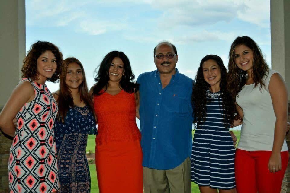 Amer Othman Adi, fourth from left, with his wife and daughers. (Photo: Haneen Adi)