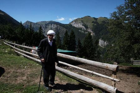 An old man is pictured in Liqenat/The Lakes in Kosovo, near the border with Montenegro, August 28, 2016. REUTERS/Hazir Reka