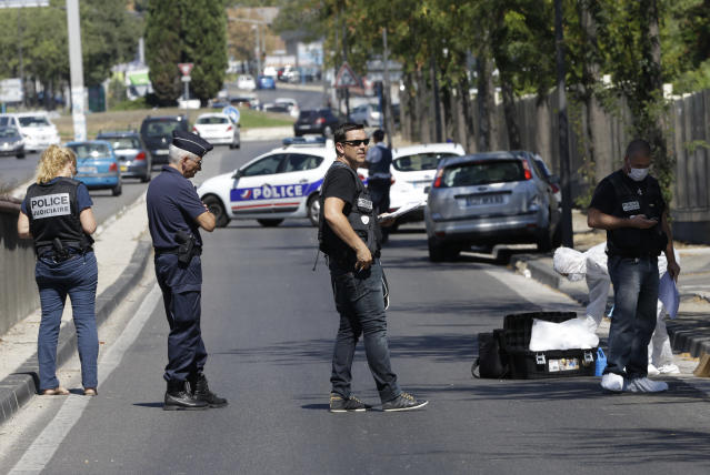 <p>Police officers block the road near a bus stop in La Valentine district after a van rammed into two bus stops in the French port city of Marseille, southern France, Aug. 21, 2017. (Photo: Claude Paris/AP) </p>