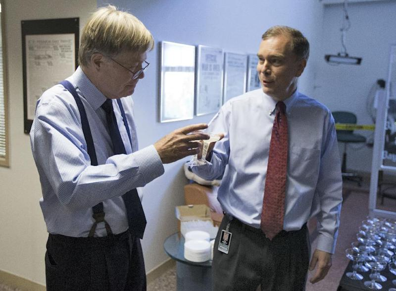 Tim Nickens, right, and Dan Ruth toast each other after they won the Pulitzer Prize for editorial writing Monday, April 15, 2013, in St. Petersburg, Fla. The pair won for their series of editorials on Pinellas County's decision to fluoridate resident's water. (AP Photo/Chris O'Meara)